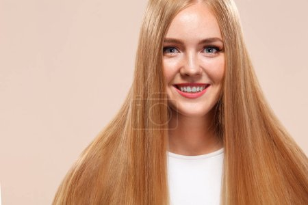 Photo for Beautiful Blonde Woman Beauty Model Girl with perfect makeup and long straight hair on light copyspace - Royalty Free Image