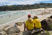 SYDNEY, AUSTRALIA - JANUARY 13, 2018: Lifeguards patrolling Freshwater Beach Australia. Freshwater Beach in Sydney is patrolled by lifeguards making the beautiful beach safe and easy for families
