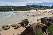 SYDNEY, AUSTRALIA - JANUARY 13, 2018: Freshwater Beach in Sydney. People enjoying a summer day on Freshwater Beach, a beautiful family patrolled sandy beach in Sydney