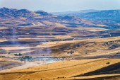 Landscape of valley with fires in fields in Morgantina, Enna province, Sicily, Italy