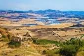 Landscape of valley with fires in fields in Morgantina, in Enna province, Sicily, Italy