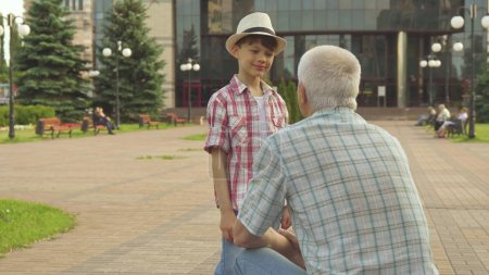Senior man highfives with his grandson
