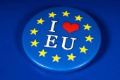 London, UK - November 20th 2018: I Love the EU pin badge, pictured over a blue background.