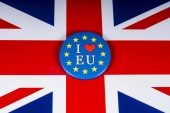 London, UK - November 20th 2018: I Love the EU pin badge, pictured over the flag of the United Kingdom.