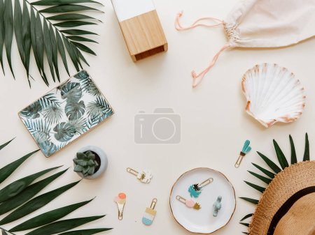 Flat lay summer composition. Creative concept tropical leaves and invitation card. Top view, copy space