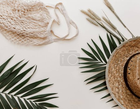 Flat lay summer composition. Creative concept tropical leaves and ears of wheat. Top view, copy space