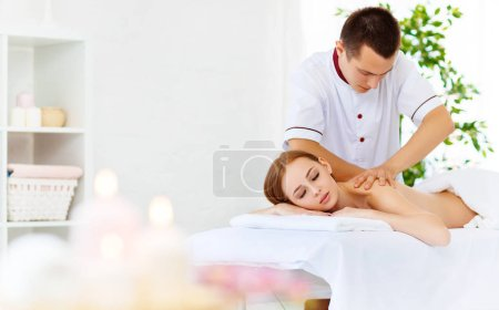 Photo for Beautiful girl enjoys massage and spa treatments - Royalty Free Image