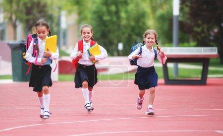 Photo for Happy children girls girlfriend schoolgirl student elementary school - Royalty Free Image
