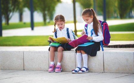 Photo for Ppy children girls girlfriend schoolgirl student elementary schoo - Royalty Free Image