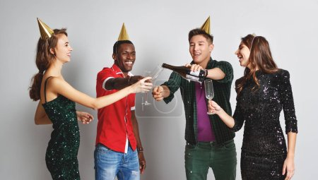 Photo for Corporate party happy friends dancing with confetti and champagn - Royalty Free Image