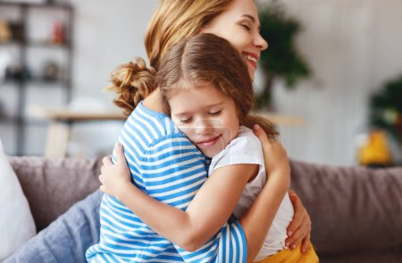 Photo for Happy mother's day! a child daughter   hugs and congratulates mother - Royalty Free Image
