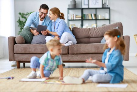 Photo for Happy family mother father and kids draw together at a home - Royalty Free Image