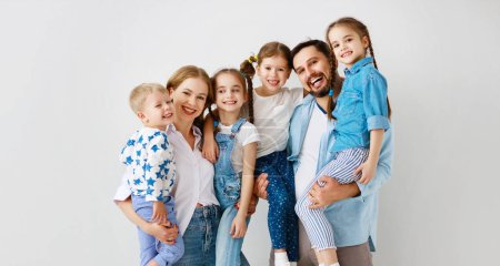 Photo for Happy large family mother father and children sons and daughters on white background - Royalty Free Image