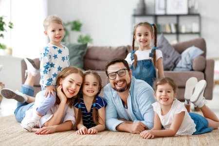 Photo for Happy large family mother father and children sons and daughters at home - Royalty Free Image