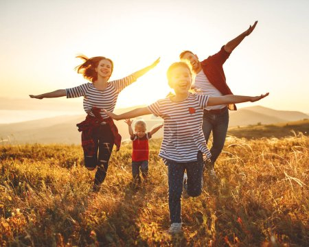Photo for Happy family: mother, father, children son and  daughter on nature  on sunse - Royalty Free Image