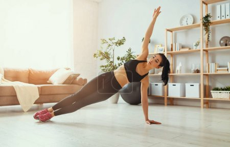 young woman doing fitness and sports at home