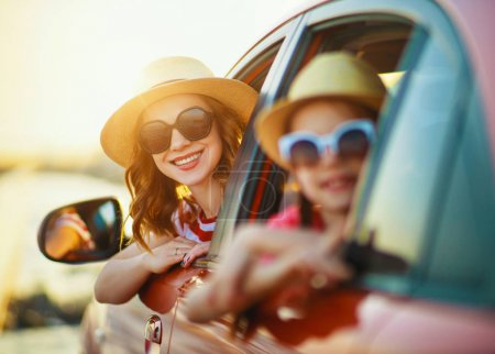 Photo for Happy  family mother and child girl goes to summer travel trip in the ca - Royalty Free Image