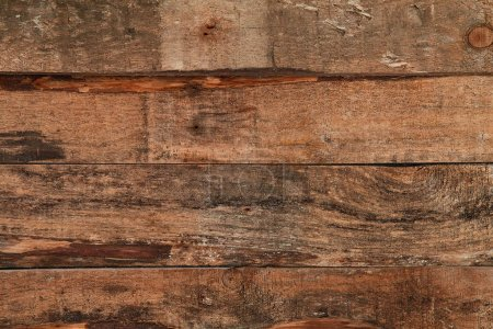 Photo for Simple abstract background of rough textured and shabby wooden surface in stains. - Royalty Free Image