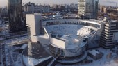 Aerial view of futuristic modern glass buildings in the city center in winter sunny day. Action. Urban landscape