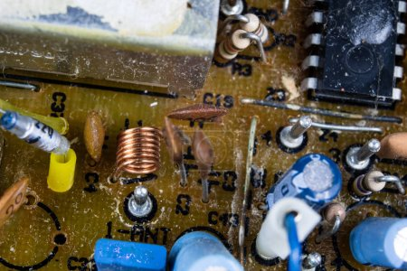 Photo for Old integrated circuits in an analog radio receiver. Resistors, transistors and other circuits on an old integrated circuit board. Workplace - workshop. - Royalty Free Image