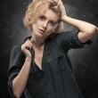 Beautiful young blonde girl with disheveled hairst...