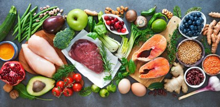 Photo for Balanced diet food background. Organic food for healthy nutrition, superfoods, meat, fish, legumes, nuts, seeds and greens - Royalty Free Image