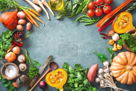 Photo for Healthy or vegetarian nutrition concept with selection of organic autumn fruits and vegetables on rustic wooden table - Royalty Free Image