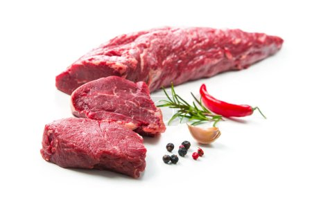 Photo for Fresh and raw beef meat. Whole piece of tenderloin with steaks and spices ready to cook isolated on white background - Royalty Free Image