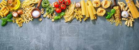 Photo for Various pasta over stone background. Top view with copy space - Royalty Free Image