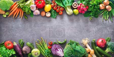 Photo for Healthy food concept with fresh vegetables and ingredients for cooking. Top view with copy space. Dark background - Royalty Free Image