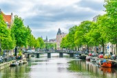 Amsterdam May 18 2018 - The Kloveniersburgwal channel with in the background bridges and the old city of Amsterdam