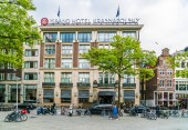 Amsterdam May 18 2018 - tourist entering the five star Grand Hotel Krasnapolsky located on the Dam square in the center of Amsterdam
