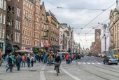 Amsterdam May 18 2018 - tourist and locals walking on the Damrak. The street from the Central train station to the Dam square