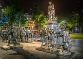 Amsterdam May 18 2018 - Night view of the statues based on the famous Rembrandt painting The Nightwatch on the Rembrandtplein in the center of Amsterdam