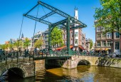 Amsterdam, May 7 2018 - the Aluminium bridge letting people cross the Kloveniersburgwal channel