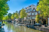 Amsterdam, May 7 2018 - The Looiersgracht with in the back locals drinking at a terrace on a sunny day