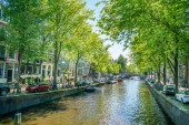 Amsterdam, May 7 2018 - The Prinsengracht with tourist enjoying the city sailing on the channel on a sunny day
