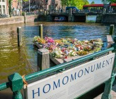 Amsterdam, May 7 2018 - The Gay monument (homomonument) at the Keizersgracht with flowers days after liberationday on a sunny afternoon