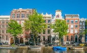 Amsterdam, May 7 2018 - The Keizersgracht with tourist wandering and traditional buildings on a sunny day