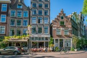 Amsterdam, May 7 2018 - locals and tourists enjoying a drink at a terrace on the Noordermakrt in the old part of town