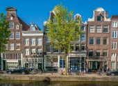 Amsterdam, May 7 2018 - The Brouwersgracht with traditional houses and tourist wandering