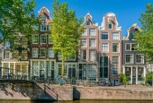 Amsterdam, May 7 2018 - The Brouwersgracht with traditional houses and part of pedestrians bridge