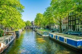 Amsterdam, May 7 2018 - The Brouwersgracht with traditional houses and floating houses