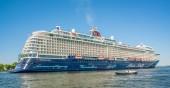 Amsterdam, May 7 2018 - Passengers sailing into the harbor of Amsterdam on a big German cruiseship of TUI Cruises