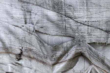 Photo pour Abstract texture of the shabby old fiberglass, as a background for the design - image libre de droit