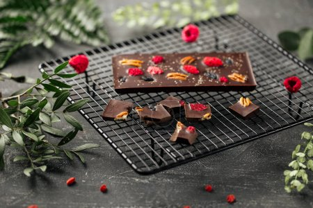 Photo for Handmade chocolate bar with pecan nuts and dried berries - Royalty Free Image
