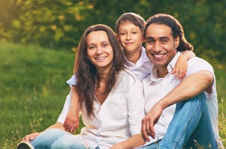Portrait of an international family sitting togeth...