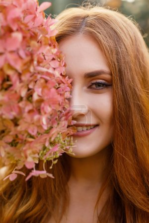 Photo for Beautiful young woman with long hair in a wreath of flowers - Royalty Free Image