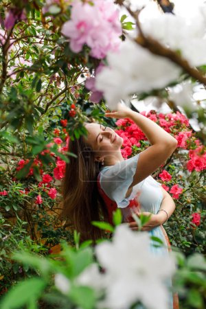 Photo for Beautiful girl in a wreath of flowers - Royalty Free Image