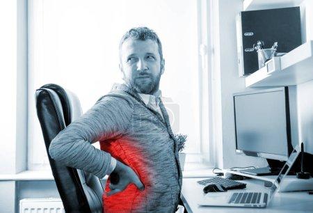 Man in desk office suffering from back pain